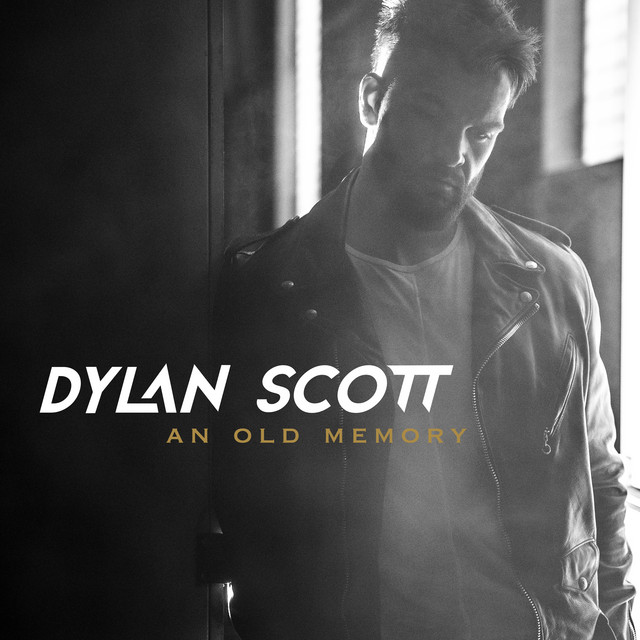 The album cover for Between An Old Memory And Me by Dylan Scott
